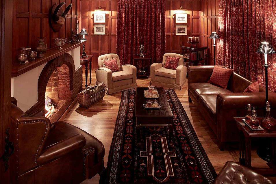 Architectural photography, wood panelled lounge with fire place