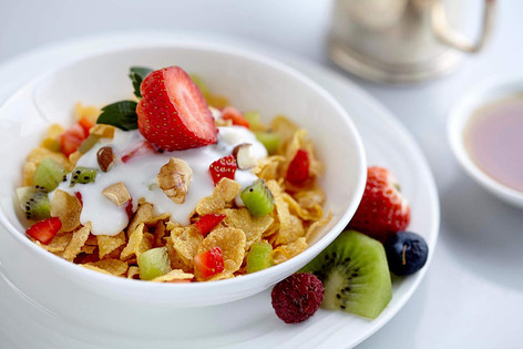 Food photography, breakfast cereal and fruits in white bowl