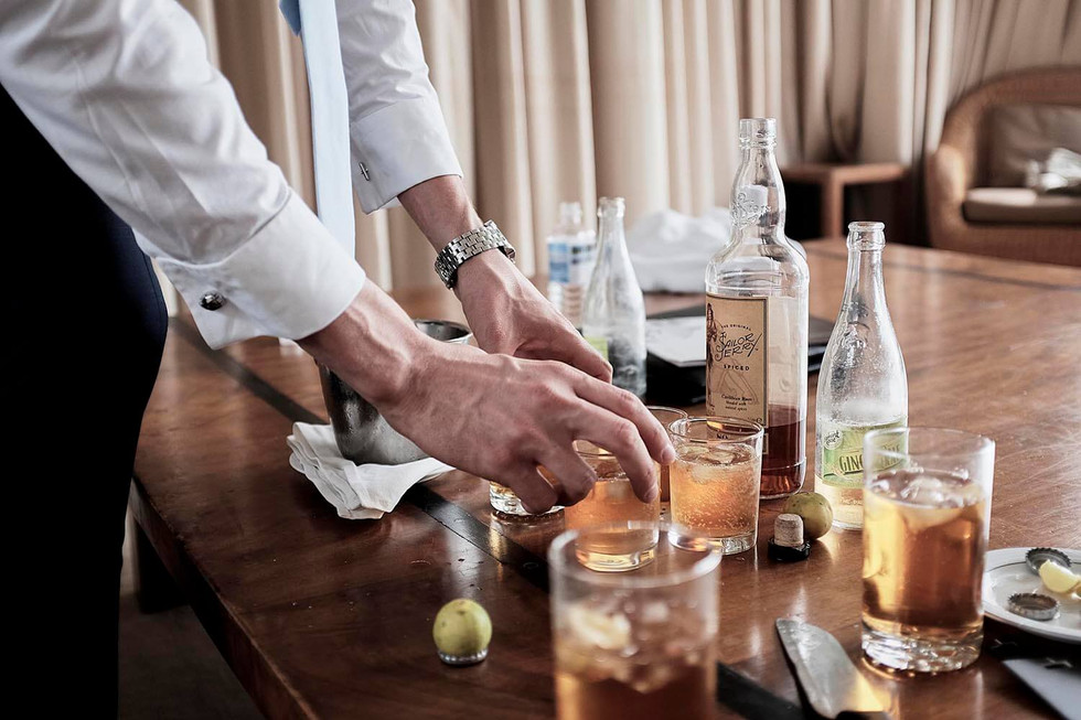 Wedding photography Tasmania, groom and drinks, whisky and ginger ale