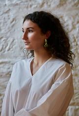 Girl in white modeling Tasmanian handmade jewelry