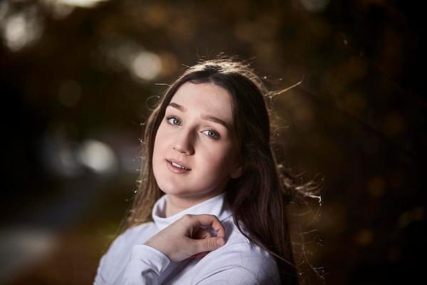 Outdoor portrait, backlit girl in autumn forest