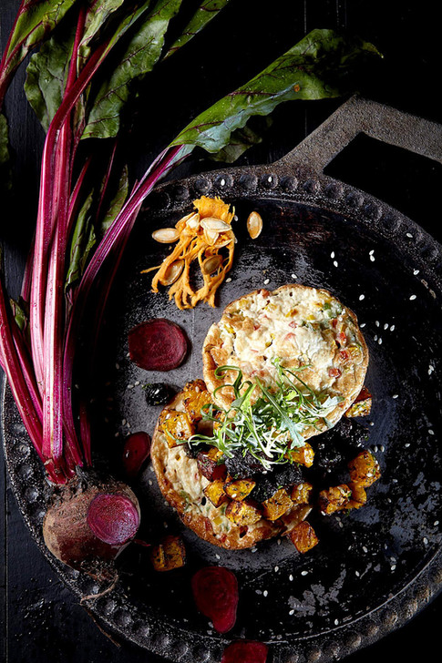 Food photography, healthy beetroot dish on iron plate