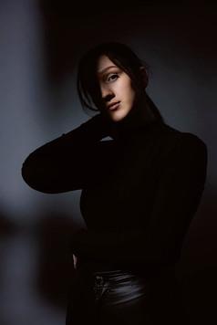 Studio portrait of dramatic lighting on model