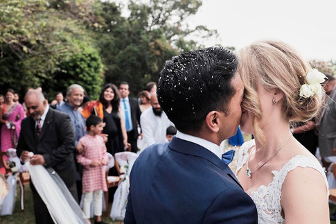 Wedding photography Tasmania, garden wedding celebrations groom kisses bride