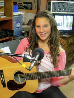 Brenna with guitar in studio IMG_0128.jpg