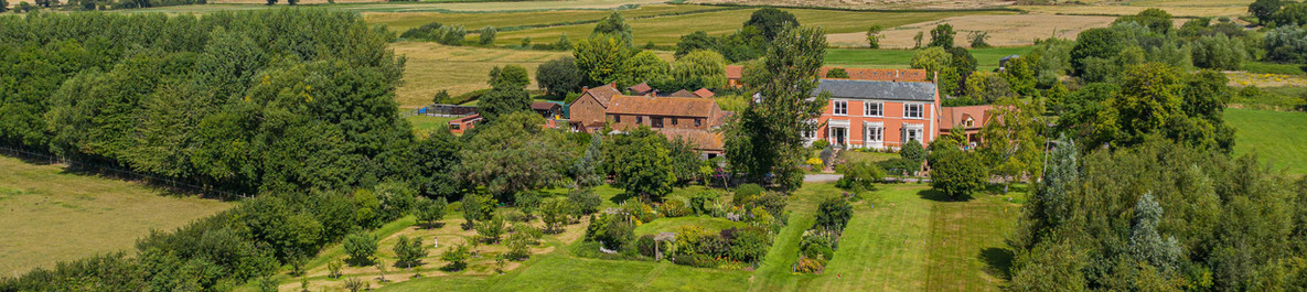 Model Farm in Somerset from the air using a drone. This property is surrounded by the green Quantock Hills