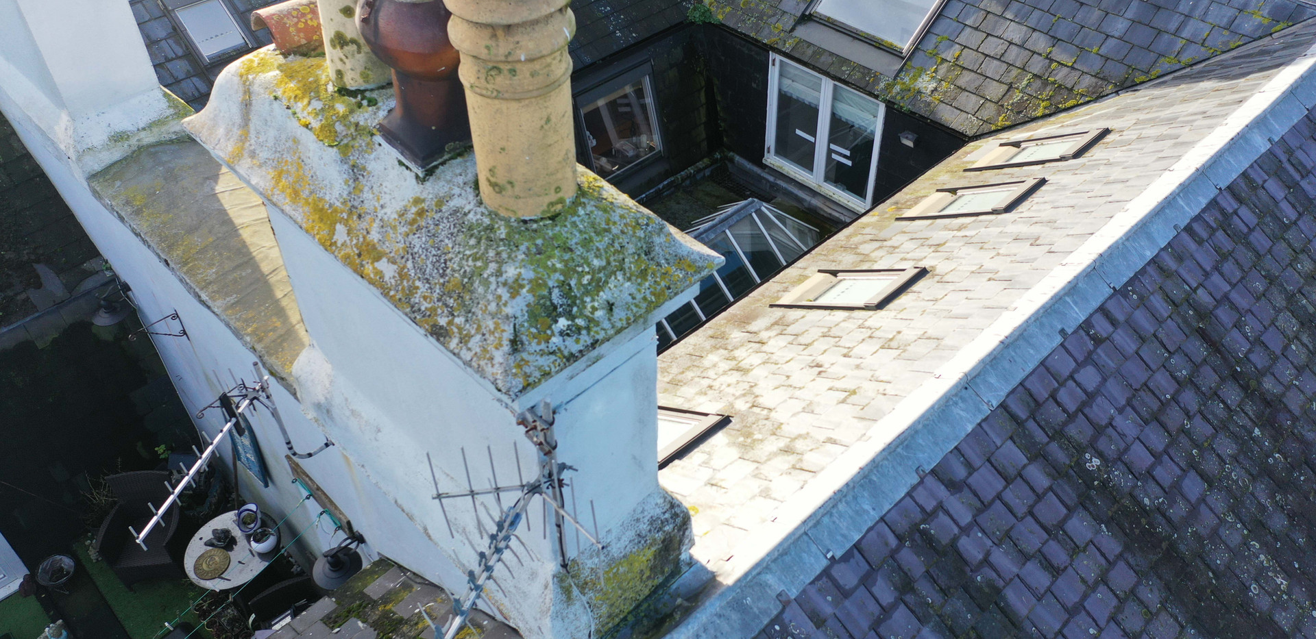 Roof survey of a damaged roof with a drone