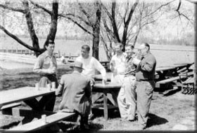 A conversation in the 1950's among Oliver Wood (seated), Bill Mulvey, Sr., Bing Murray, Richard Mulvey and E.C. 'Lauty' Lautenslager, an artist whose illustrations captured many aspects of life at SYC.