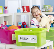 Kid sorting items for donation