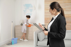 Housekeeping manager checking maid work
