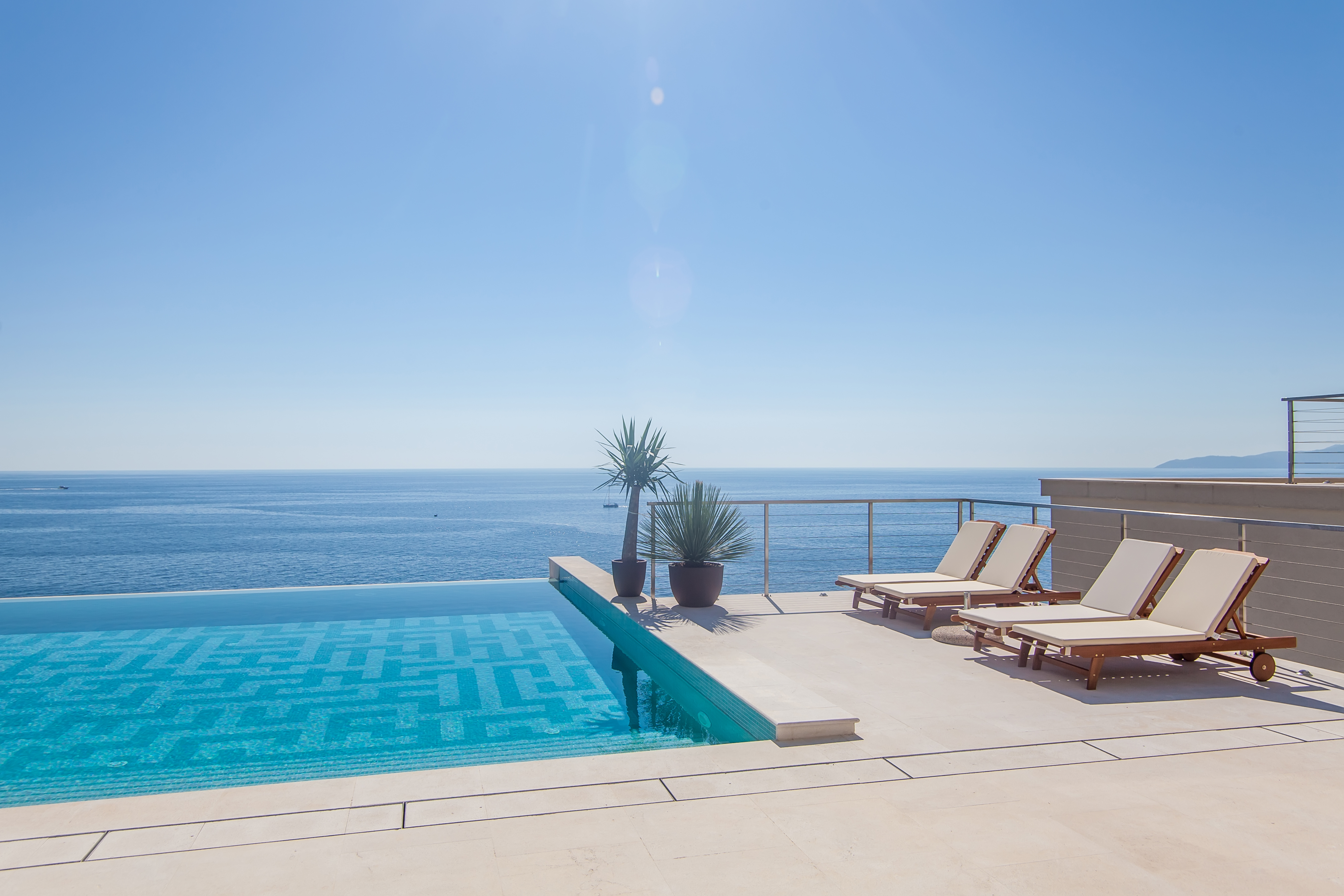 Luxury swimming pool and blue water at t