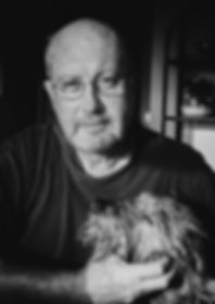 Pictue of J. Calvin Harwood a home with dog, Darci
