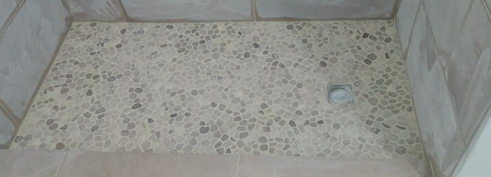 Pebbles used on shower floor