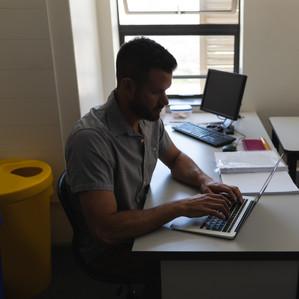school-teacher-working-on-laptop-in-clas
