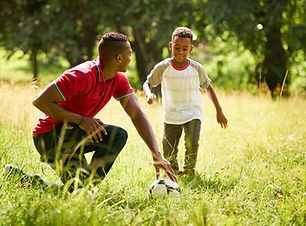 sport-practice-with-father-teaching-son-