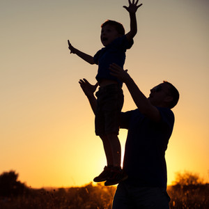 father-and-son-playing-in-the-park-at-th
