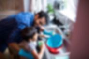 father-and-son-cleaning-utensils-at-home