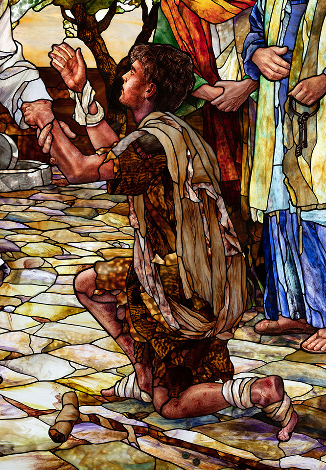 A beggar being progressively healed by Christ from leprosy.