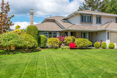 Luxury house with freshly mown grass law