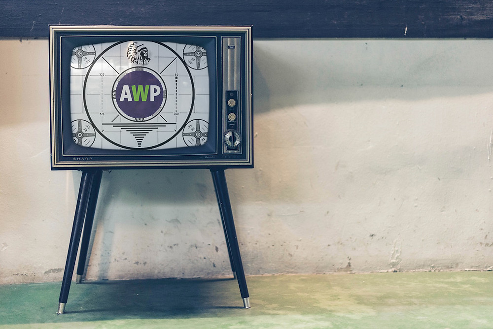 Old television with A Willing Participant, Inc. logo