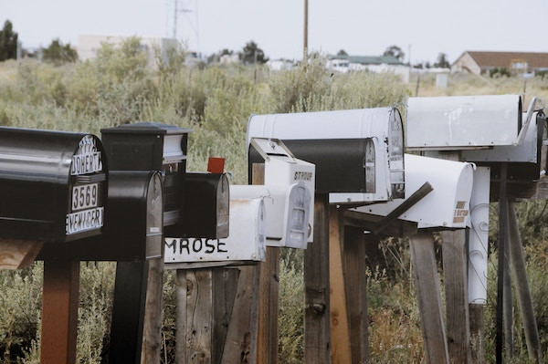 Row of mailboxes on rural road