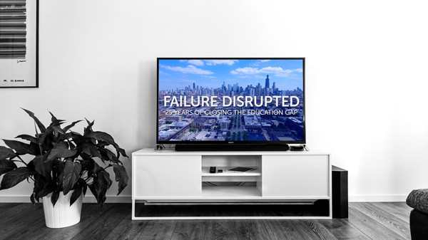 """Flat-screen television displaying """"Failure Disrupted"""" mini-documentary"""