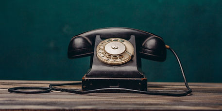 old black telephone on dark background_e