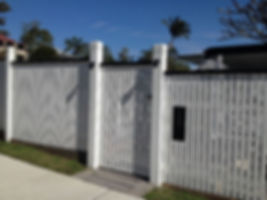 Feature fence with chunky posts and dressed smooth palings