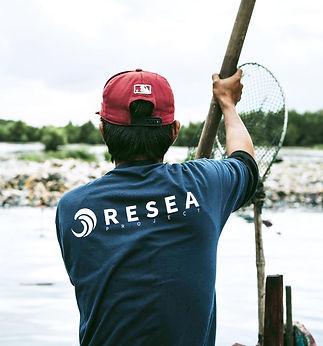 Fisherman-at-boat-looking-at-a-big-plast