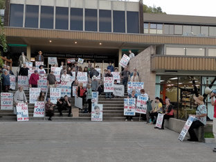 Community Rallies while Council Meets
