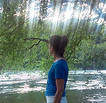 Dana Eakins of Myofascial Healing overlooking the French Broad river in Asheville NC