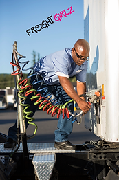black-man-truck-driver-attaching-power-cables-from-R42PPC4.webp