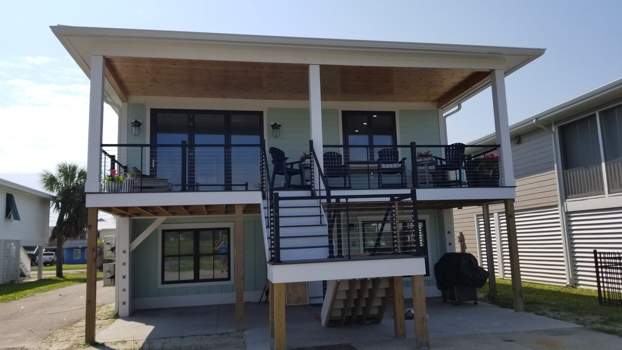 Custom Remodel Exterior with Shiplap Ceiling and Cable Railings