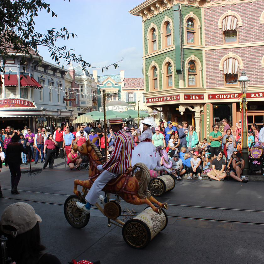 Mary Poppins and Bert in a parade on Main Street USA
