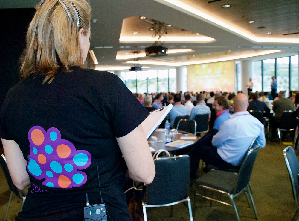 Serious Woo at the finance team conference with people