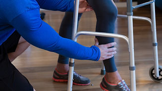 physiotherapist-helping-patient-to-walk-