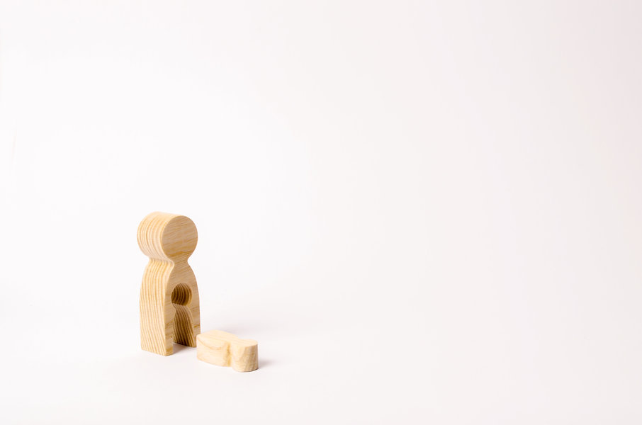 A wooden figure of a woman with a void f