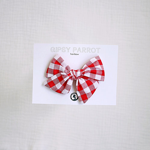 Red gingham rusettipinni