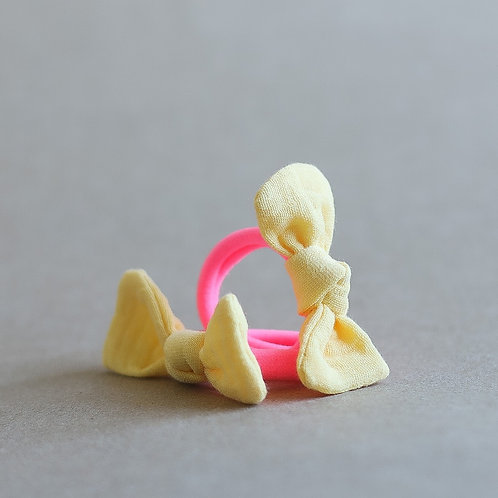 Neon pink / banana hairbands x 2