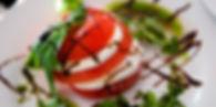 A mozzarella and tomato stack with balsalmic drizzle.