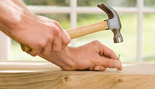 home remodeling contactor hammering nail