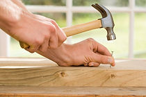 Carpentry work or repairs | hammering a nail