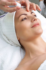 Beautiful woman receiving facial with the best Le Mieux anti-aging serums for plump, healthy, radiant skin