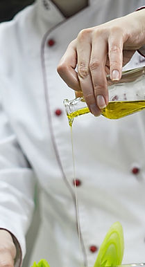 Olive oil being drizzled.