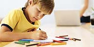 Boy, European American, drawing with colored pencils