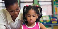 Teacher, African American, helping girl, African American