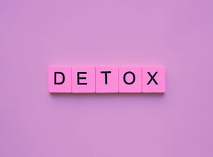 Detox word wooden cubes on pink backgrou