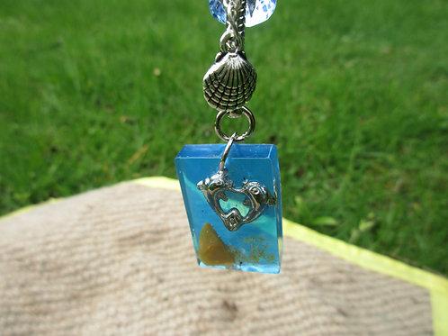 Schlüsselanhänger aus transparentem Harz.