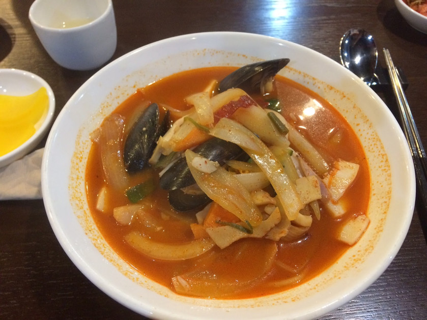 Spicy Seafood noodle soup - clams, mussels, fish cakes and soy noodles in a chilly filled broth