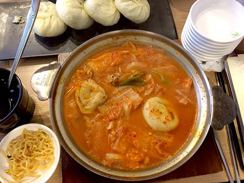 Mandu soup with seafood. In Korean, Mandu means dumpling. At a small roadside eatery; Gangnam